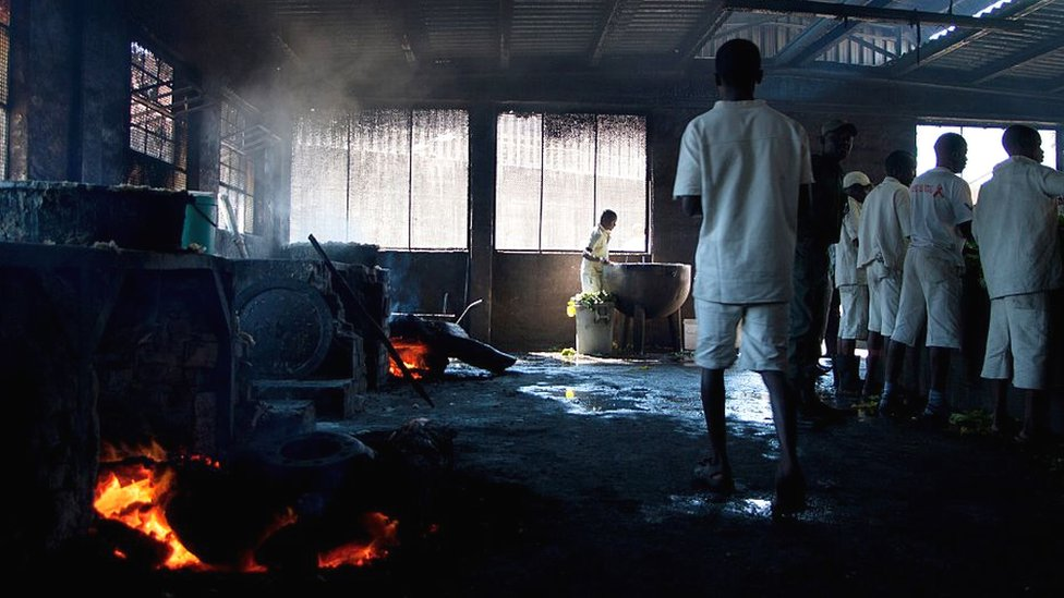Inmates at Chikurubi Prison in the kitchen during a parliamentary committee visit in 2015