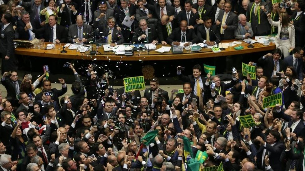 "Opposition lawmakers celebrate after the lower house of Congress voted to impeach Brazil""s President Dilma Rousseff in the Chamber of Deputies in Brasilia, Brazil, Sunday, April 17, 2016"
