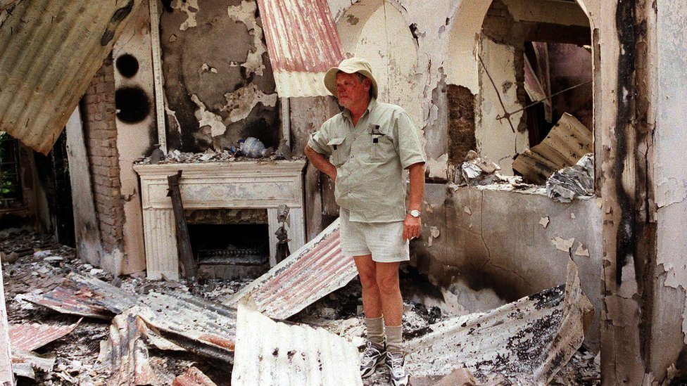 Dup Muller, 59, a commercial farmer in Headlands, 110 kilometres, (70 miles) East of Harare, shows his 17th. century clock, 11 August 2002, that was destroyed when his farm house was burnt by suspected war veterans