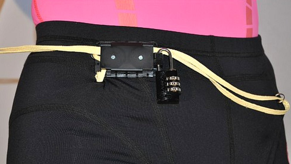 Close up of shorts with lock and alarm