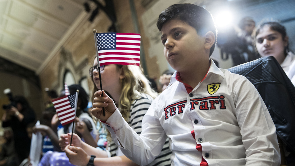 Hoyannee Malatchanyan, a 10 year-old from Armenia, waves the American flag after taking the Oath of Allegiance to become a U.S. citizen during a citizenship ceremony at The Bronx Zoo, May 5, 2017