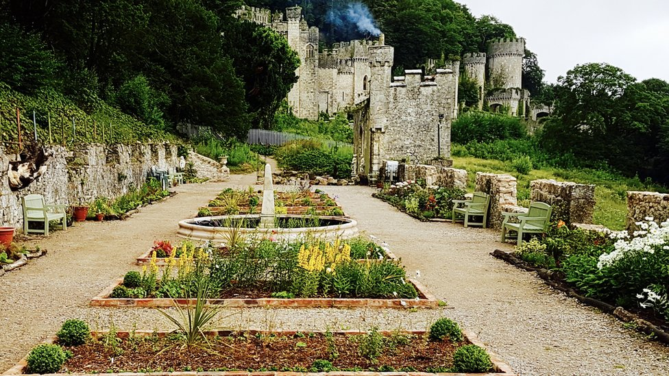 Restored gardens with the castle in the background