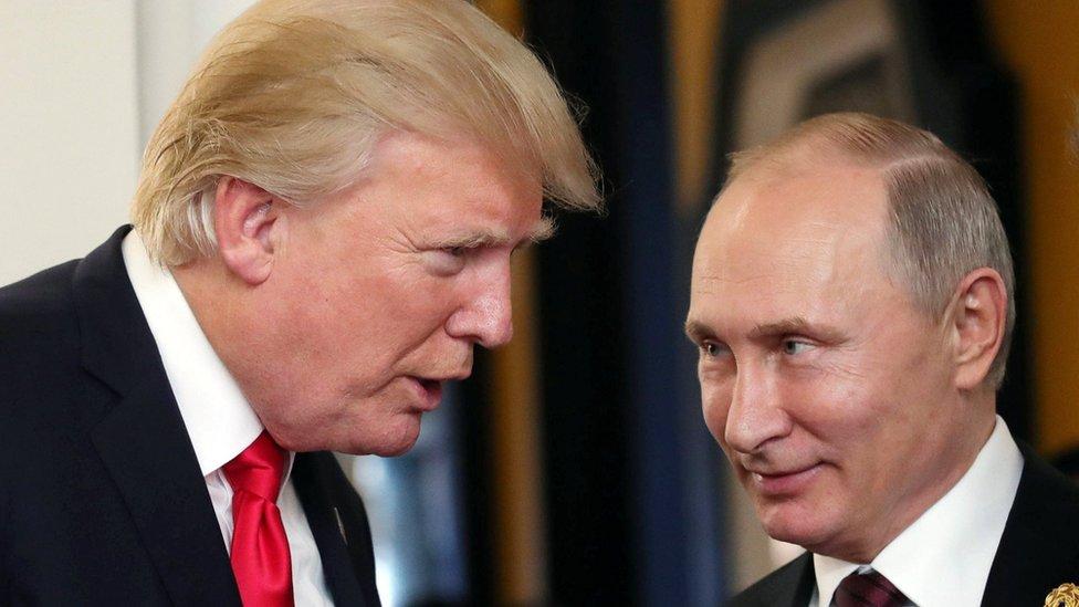 Russian President Vladimir Putin (R) and US President Donald J. Trump (L) talk at a summit in Da Nang, Vietnam, (11 November 2017)