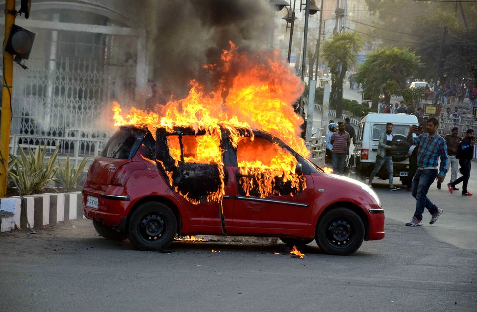 """A car burns during a protest against the release of Bollywood movie """"Padmavat"""", in Bhopal on 24 January 2018."""