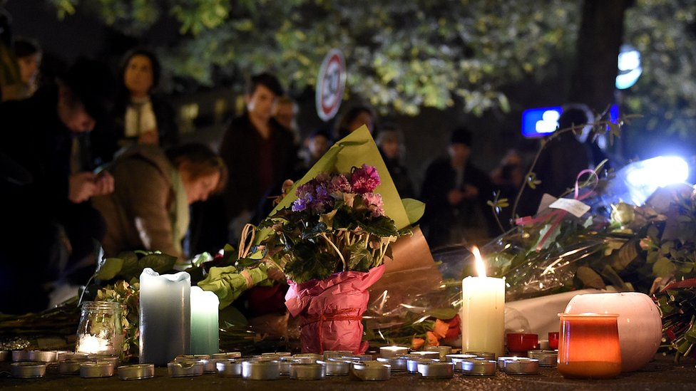 Flowers and candles near the Bataclan concert hall
