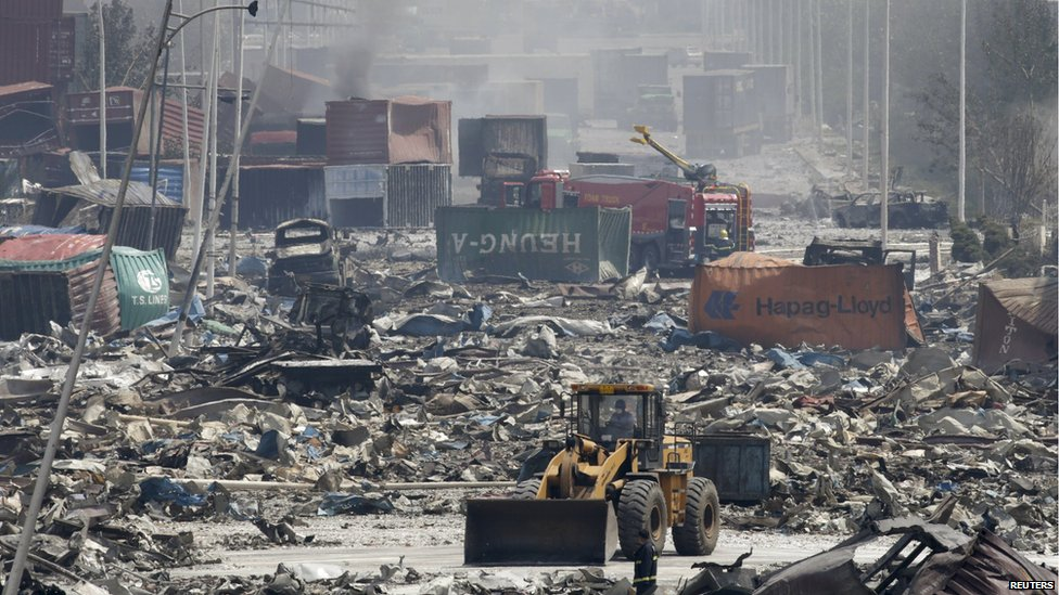 A bulldozer works near the site of the explosions at the Binhai new district, Tianjin, August 13, 2015.