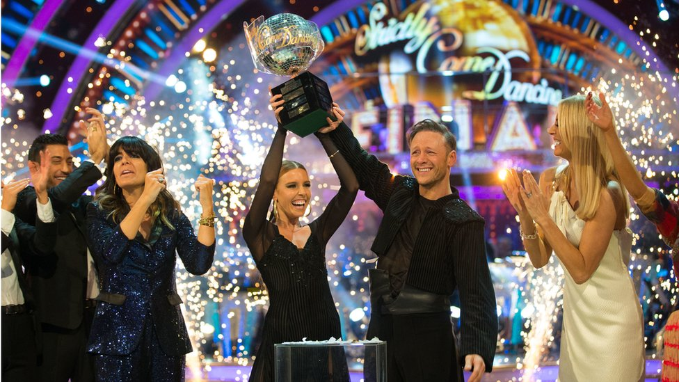 Stacey Dooley and Kevin Clifton lift the Strictly glitterball trophy