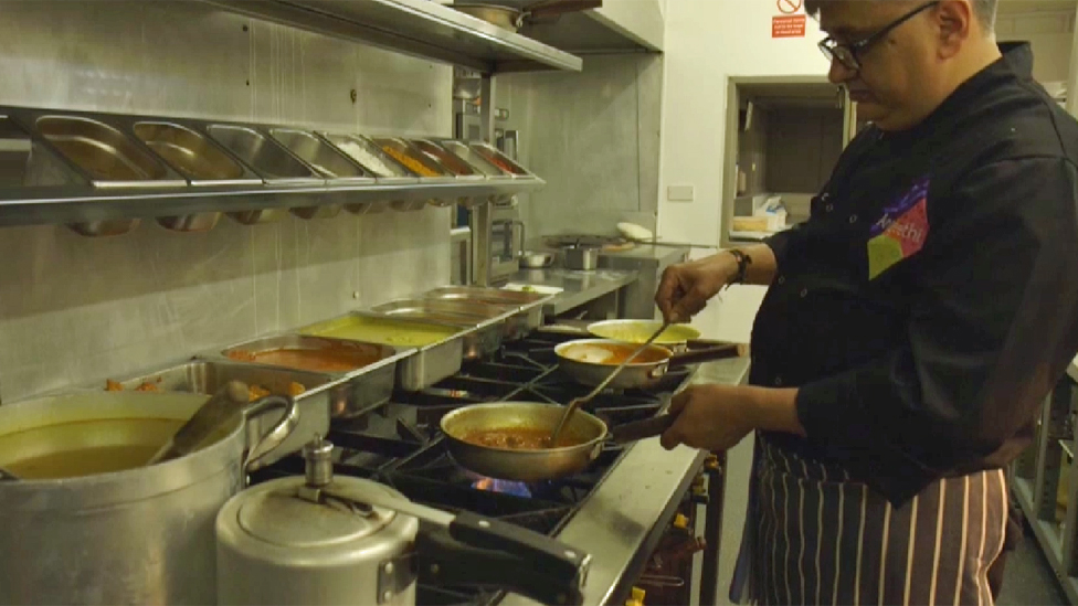 Cook preparing Indian food