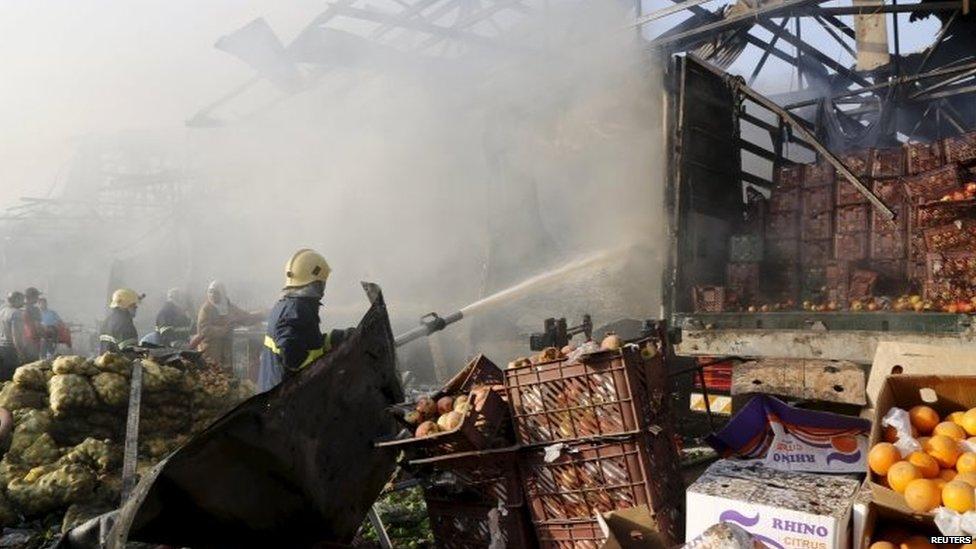Firemen fight blaze at Sadr City market 13/08/2105