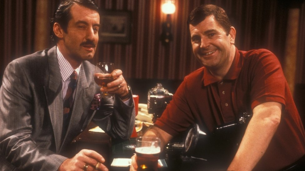 John Challis, pictured here playing Boycie (L)