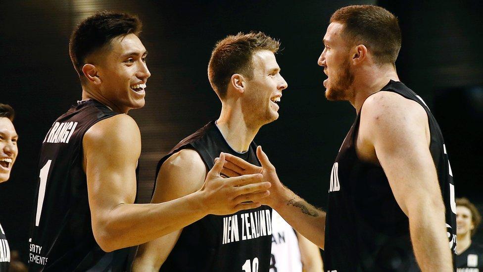 New Zealand basketball players celebrate during a match against Jordan
