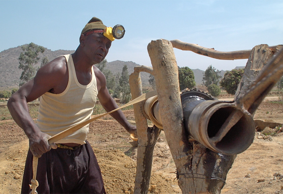 A man works the pulley system at the Barkin Ladi mine