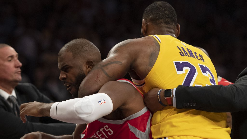 LeBron James plays peacemaker as his Lakers home debut is marred by brawl