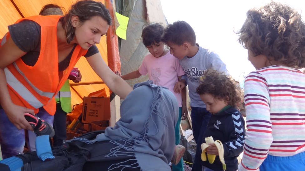 Aid worker speaks to migrants in Hungary