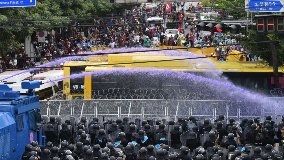 Water cannon is fired towards pro-democracy protesters near the Thai parliament in Bangkok on 17 November 2020