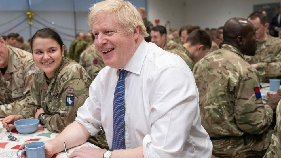 "Britain""s Prime Minister Boris Johnson meets British troops stationed in Estonia for a meal at the Tapa military base"