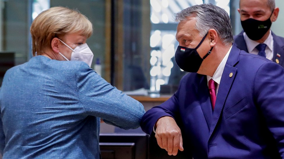 German Chancellor Angela Merkel bumps elbows with Hungary's Prime Minister Viktor Orban at the start of the second face-to-face European Union summit since the coronavirus disease (COVID-19) outbreak, in Brussels, Belgium October 1, 2020