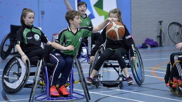 School children enjoy a game of wheelchair basketball at the Active Academy sessions in Belfast