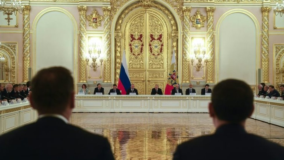 Russian President Vladimir Putin (C-R) attends a meeting with Russian business community at the Kremlin in Moscow, Russia,