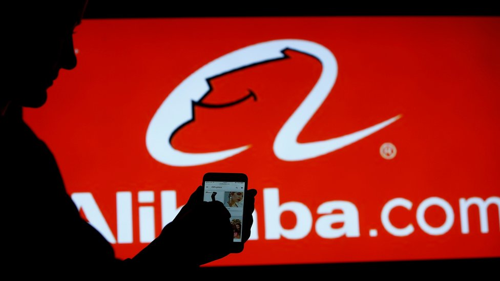 A women searches online on a mobile phone from Alibaba.com in Moscow, Russia on September 11, 2018.