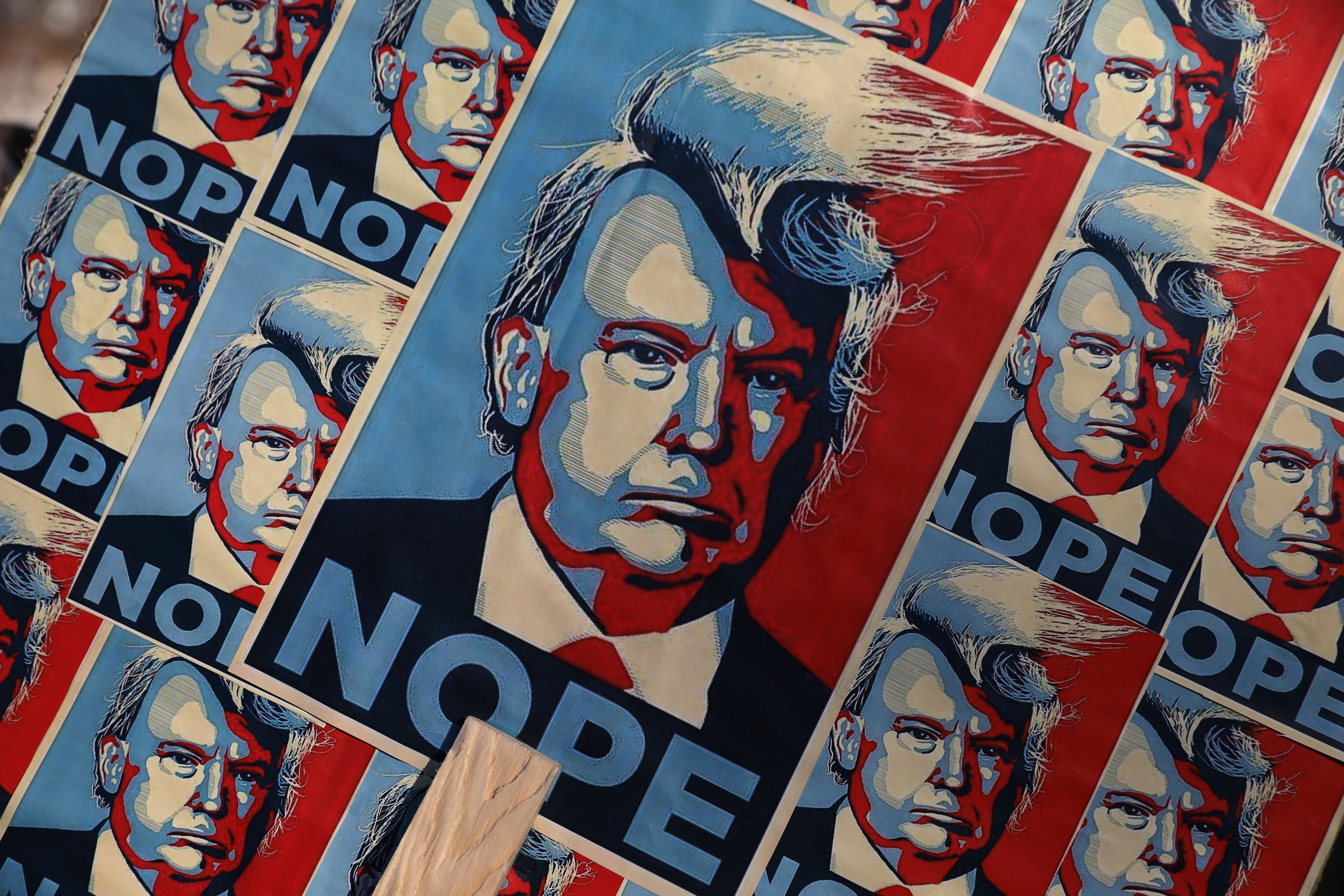 Posters showing Trump's image