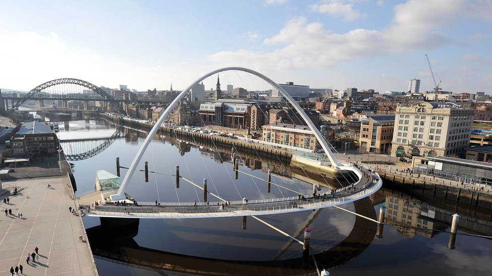 Gateshead's Millennium Bridge and Newcastle's Tyne Bridge