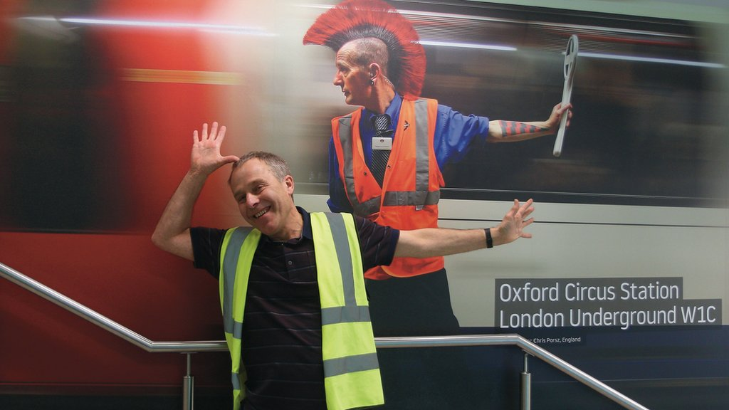 Chris Porsz with one of his images at a London Luton airport exhibition.