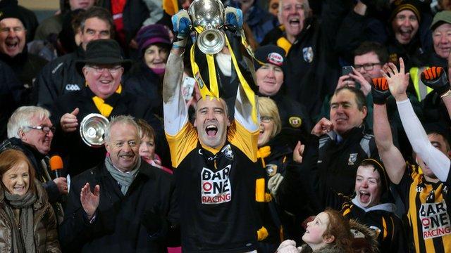 Crossmaglen captain Paul Hearty lifts the Seamus McFerran Cup after Sunday's success