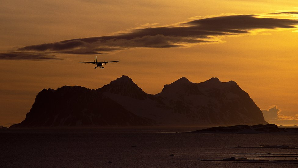 A Twin Otter Aircraft operated by the British Antarctic Survey returns back to Rothera station on the Antarctic Peninsula