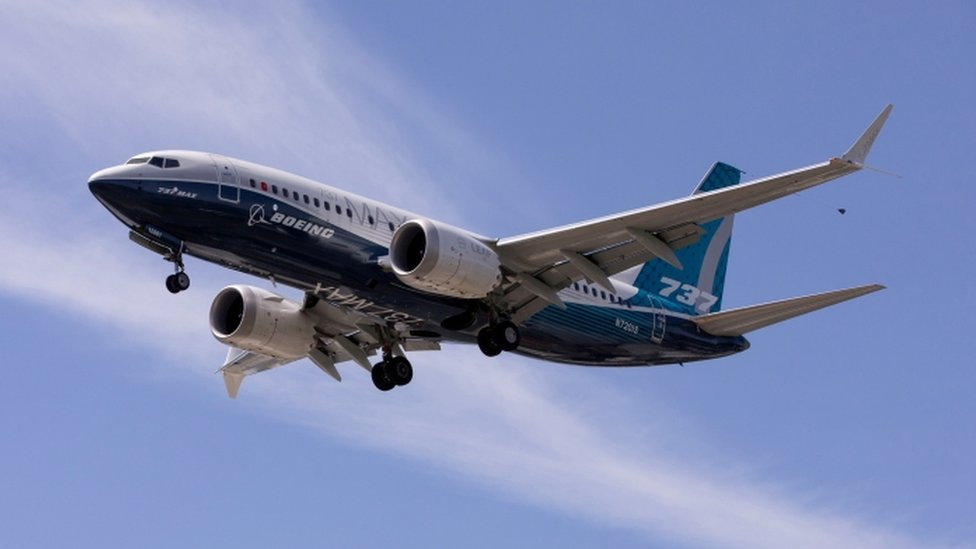 A Boeing 737 MAX aeroplane lands after a test flight at Boeing Field in Seattle.