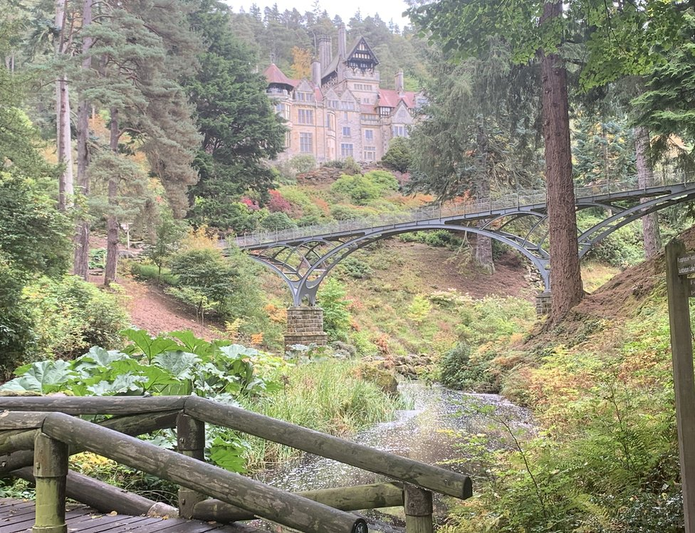 A bridge over a stream in the grounds of a house at Cragside near Rothbury in Northumberland