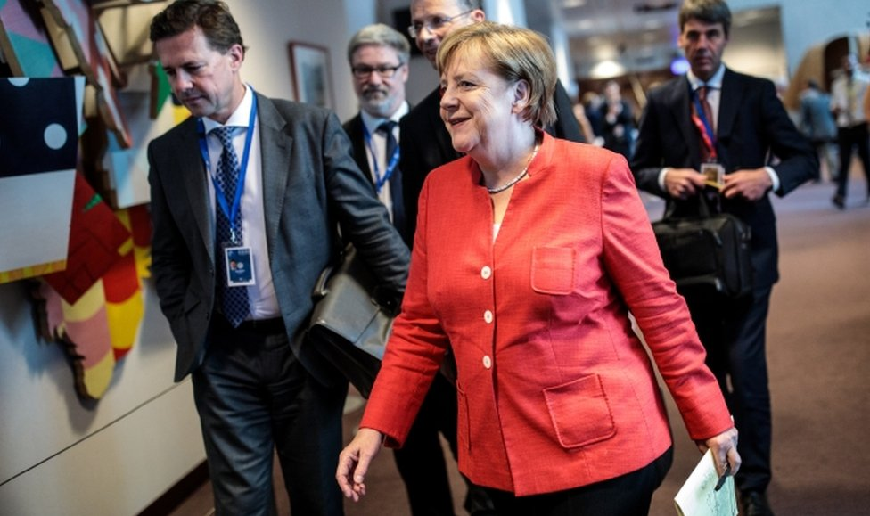 German Chancellor Angela Merkel arrives to give a news conference on the final day of the European Council leaders' summit