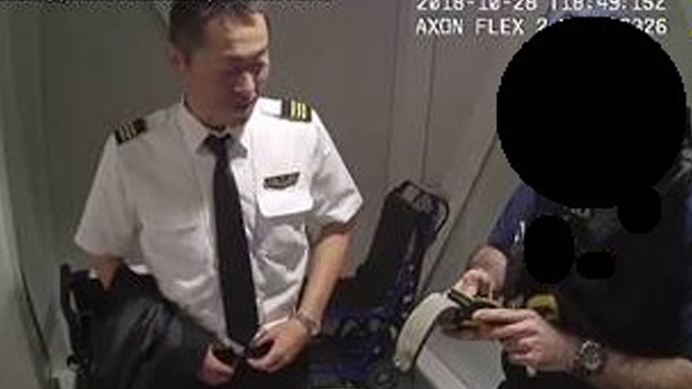 CCTV image of Katsutoshi Jitsukawa being arrested after failing a breath test