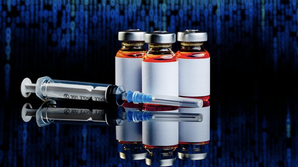 Vacuna y jeringa