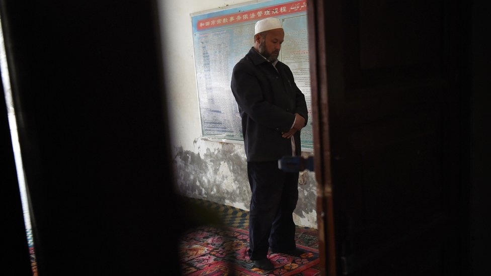 """This photo taken on April 16, 2015 shows a Uighur man praying in a mosque in Hotan, in China""""s western Xinjiang region."""