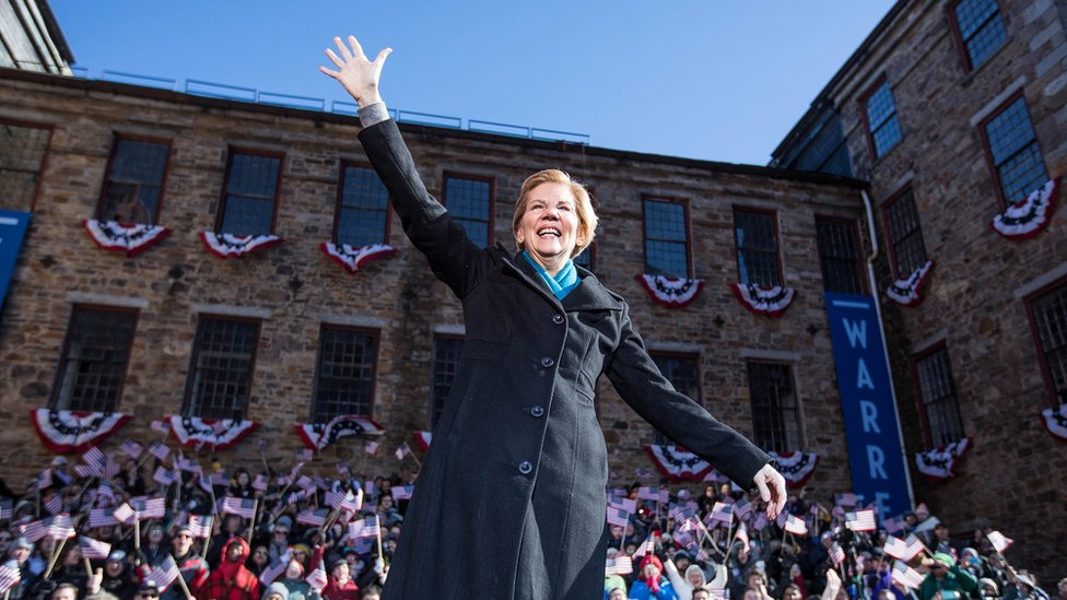 Elizabeth Warren waves at her campaign kickoff in Lawrence, Massachusetts