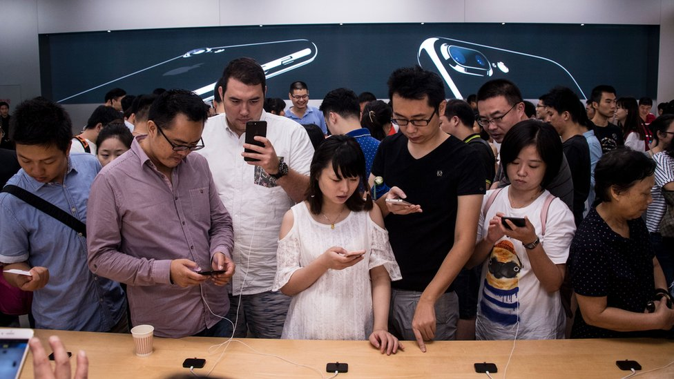 Customers in Apple's Shanghai store