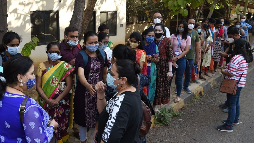 Health workers queue to receive a dose of a Covid-19 coronavirus vaccine at the Cooper hospital in Mumbai on January 16, 2021.