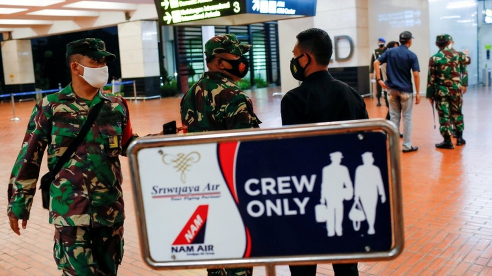 Indonesian soldiers are seen at Soekarno-Hatta International Airport after Sriwijaya Air plane disappears shortly after taking off from there in Tangerang, near Jakarta, Indonesia, on 9 January 2020