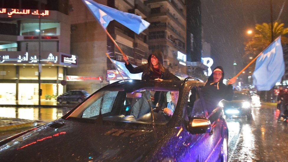 Supporters of Saad Hariri wave Future Movement flags as they celebrate in Beirut on 21 November 2017