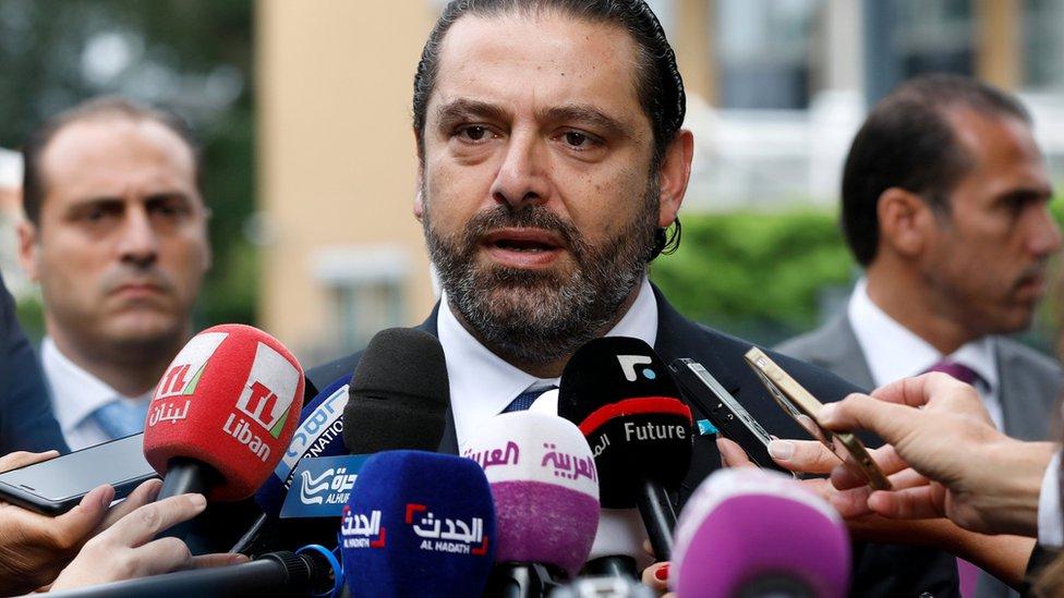 Lebanese Prime Minister Saad Hariri speaks to the media outside the Special Tribunal for Lebanon (STL) in The Hague (11 September 2018)