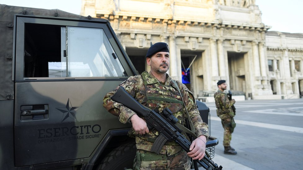 Soldiers patrol the streets in Lombardy
