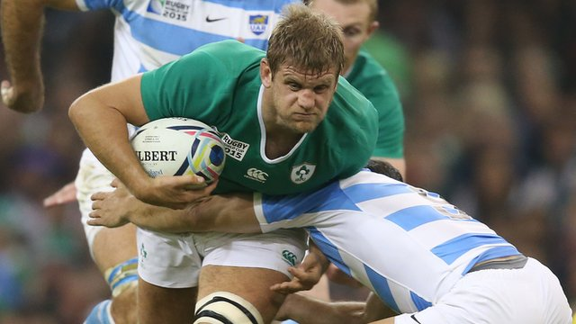 Ireland flanker Chris Henry is tackled in the World Cup quarter-final defeat by Argentina