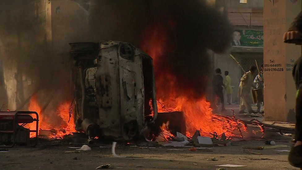 A car burning in Thursday's riot
