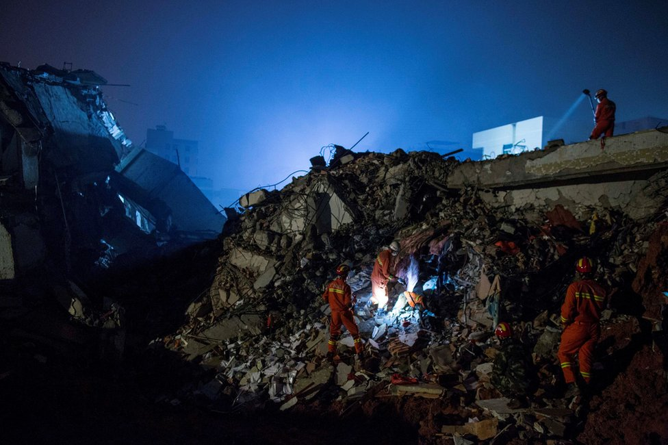 Emergency services search rubble for survivors after a landslide buried 22 buildings on 20 December 2015 in Shenzhen, China