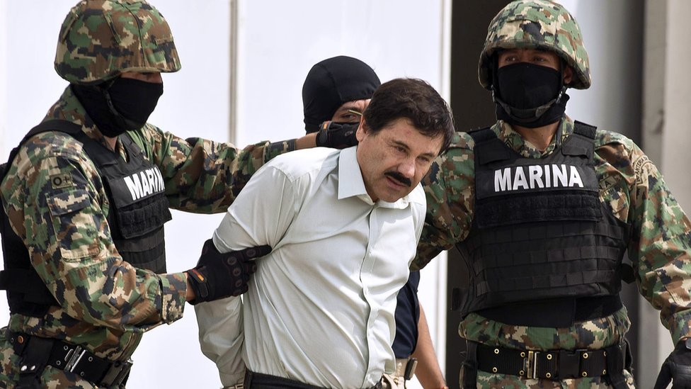 "Mexican drug trafficker ""El Chapo"" is escorted by marines after his arrest in 2014"