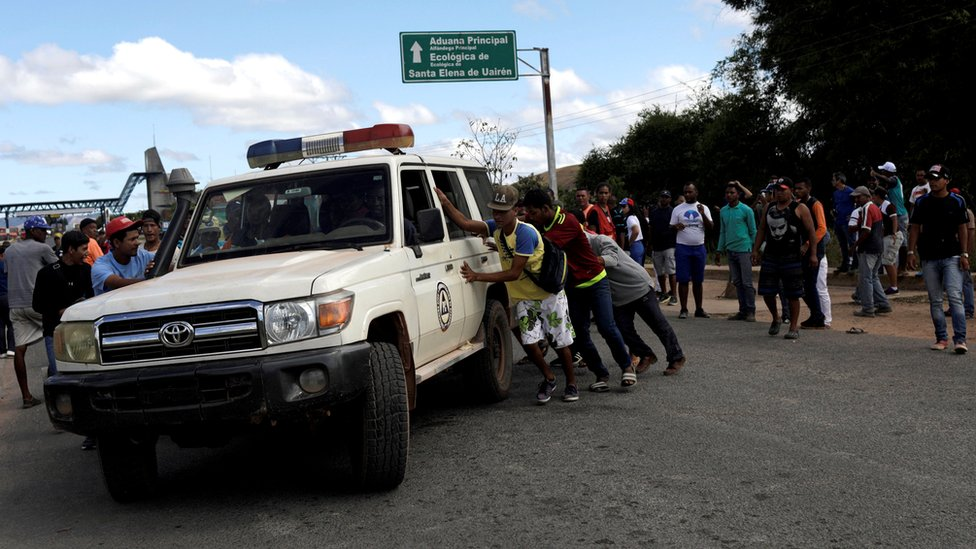 An ambulance at the scene where several people were injured during clashes in the southern Venezuelan town of Kumarakapay, 22 February 2019