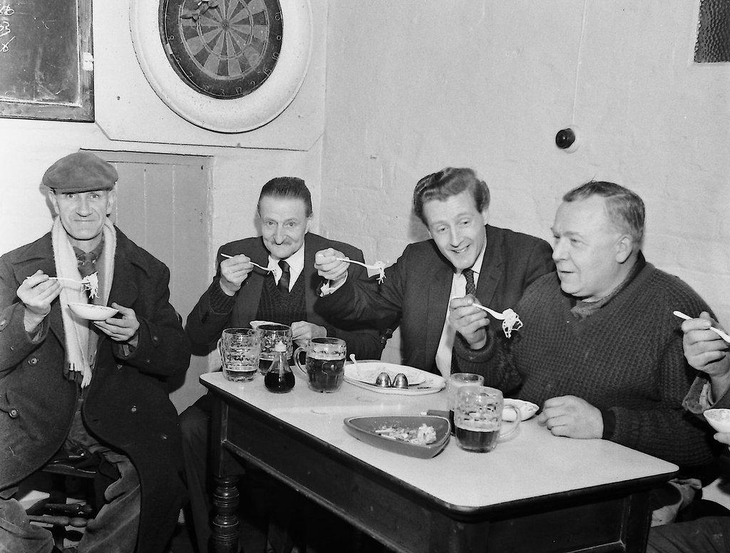 Old photo of men in Frampton