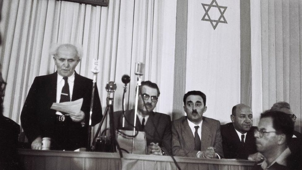 David Ben-Gurion (left) reads the Israeli Declaration of Independence on 14 May 1948