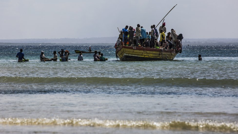 Resident fleeing violence by boat in northern Mozambique